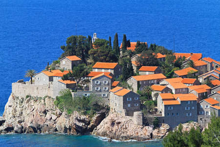 islet: Medieval houses at Sveti Stefan islet in Montenegro Stock Photo