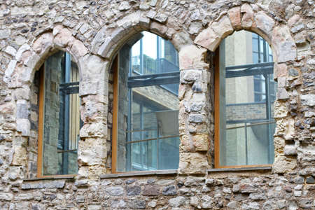 Closeup architecture detail with windows on stone house Stock Photo - 17036827