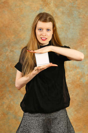Blonde woman holding card with empty space photo