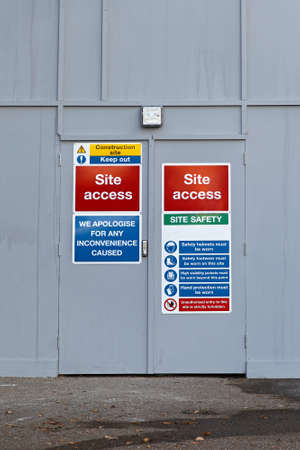 Construction site access door with warning signs Stock Photo - 17036832
