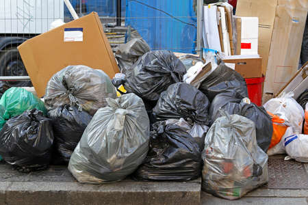 disposed: Big pile of garbage and waiste in black bags