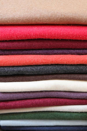 Big pile of vivid color jumpers and sweaters Stock Photo - 17036831