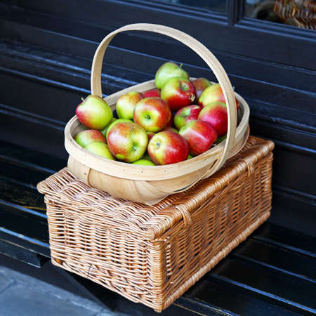Red and green apples in the basket Stock Photo - 17048716