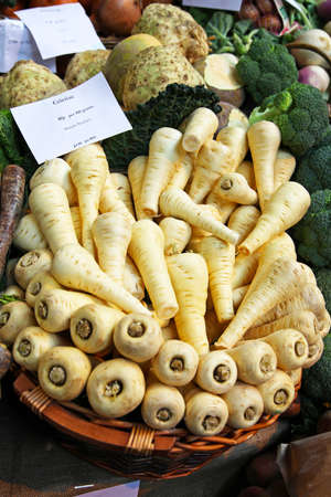 Big bunch of parsnip root vegetables at market Stock Photo - 17048705