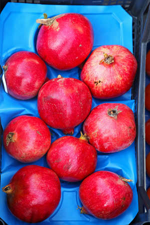 Pomegranate fruits  in crate at farmers market Stock Photo - 17048711