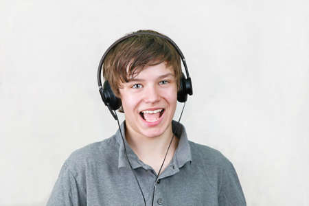 hansome: Hansome modern young boy singing with headphones Stock Photo