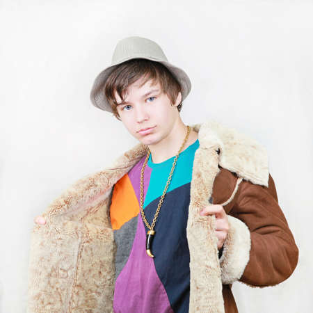 Teenage boy pimp in gang style with coat and hat Stock Photo - 17052966