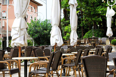 restaurant exterior: Cafe terrace with brown chairs in Opatija Stock Photo