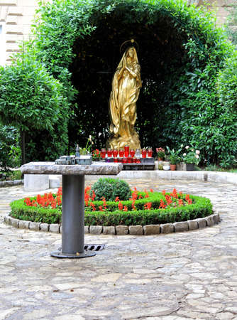 Religious statue of golden Madonna in Opatija Stock Photo - 17094488