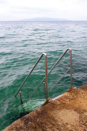 Metal stairway with handrail to the sea Stock Photo - 17094494