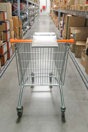 Shopping trolley in warehouse row with boxes Stock Photo - 17105138