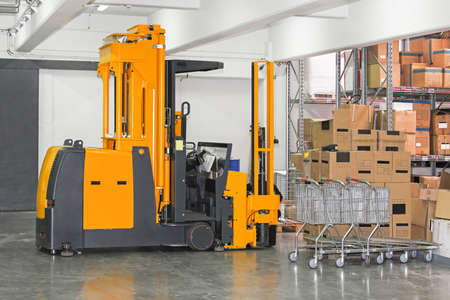 Electric forklift stacker in warehouse with boxes Stock Photo - 17105134