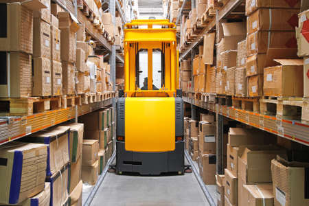 High rack stacker forklift truck in warehouse row