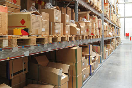 Warehouse shelf with cardboard boxes and goods photo