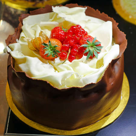 Tasty chocolate cake with strawberry decoration on top Stock Photo - 17123470