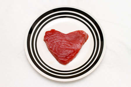 Piece of fresh tuna steak in heart shape Stock Photo - 17123485