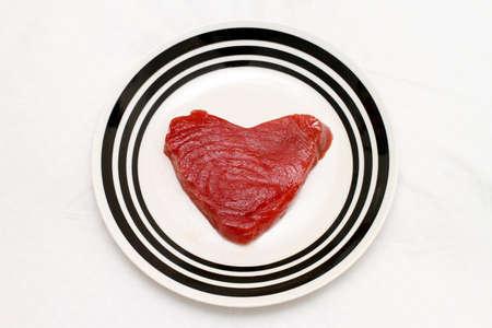 Piece of fresh tuna steak in heart shape Stock Photo - 17123485