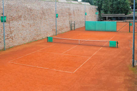 Empty tennis court made from orange clay Stock Photo - 17150813