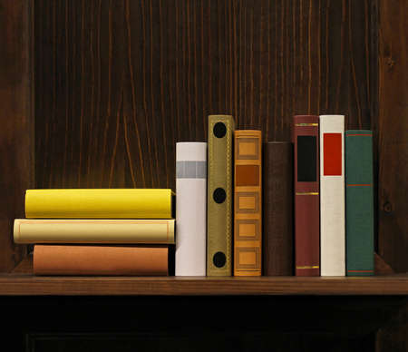 Dark wood book shelf with old books Stock Photo - 17191496