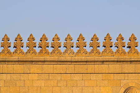 Yellow stone wall with spikes at mosque Stock Photo - 17249591