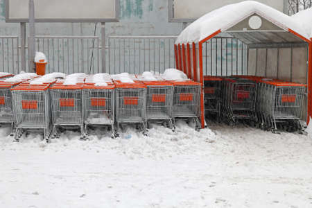 Shopping carts under the snow at supermarket parking lot Stock Photo - 17282580