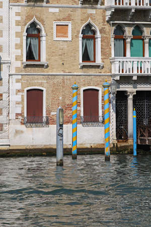 Decorative mooring poles at house in Venice Stock Photo - 17338721