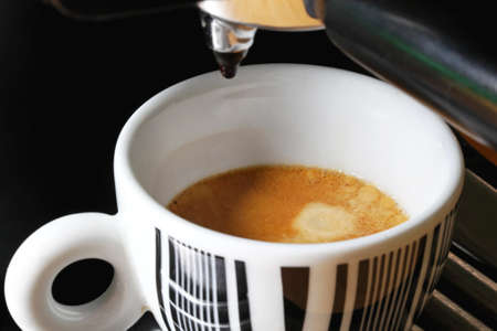 Preparing Italian espresso drink at coffee maker Stock Photo - 17690567