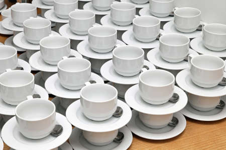 Big bunch of plain white tea cups Stock Photo - 17690572
