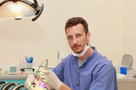 Handsome doctor and patient in dentist office Stock Photo - 17694360