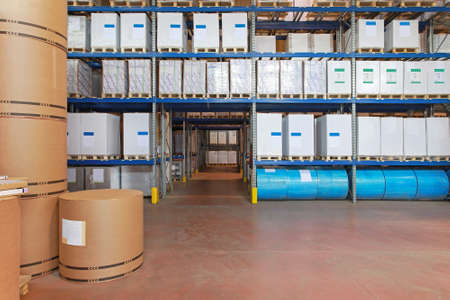 Big warehouse with paper rolls and printing material photo