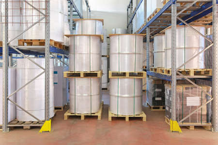 Paper rolls and printing material in warehouse photo