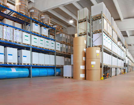Big warehouse with paper rolls and printing material