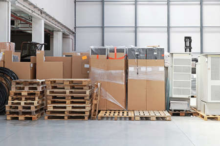 Big storage room with pallets of goods photo