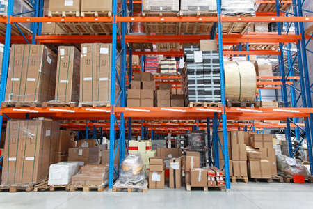 shelving: Shelving system with goods in distribution warehouse