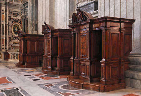 confession: Confession booth in St  Peter Cathedral in Vatican