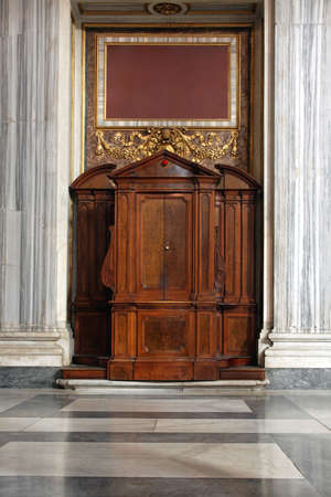 confession: Confession booth in Catholic Church in Rome