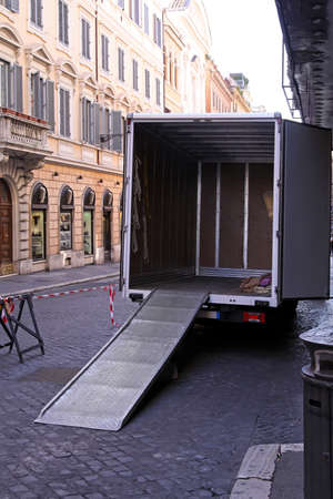 on ramp: Empty moving truck with loading ramp at Rome street Stock Photo