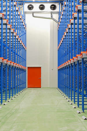 Refrigerated and freezing warehouse with blue shelves Archivio Fotografico