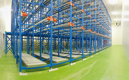 Empty shelving system in new distribution warehouse photo