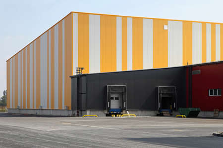 warehouse building: Exterior of new and colourful distribution warehouse