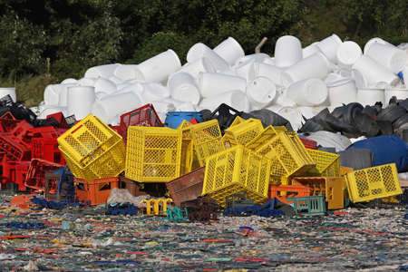 Plastic crates and barrels at recycling factory photo