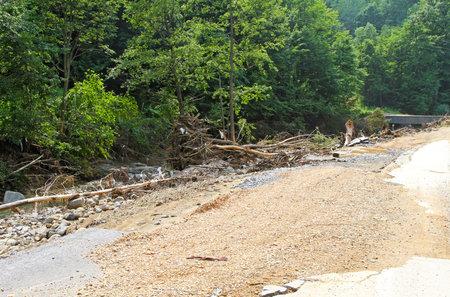 landslip: Destructive pile of debris left after river flood  Editorial