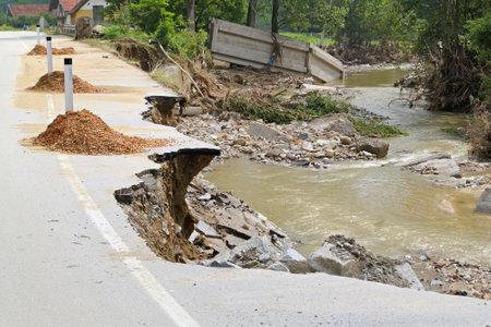 landslip: Destroyed road left with debris after river flooding Editorial