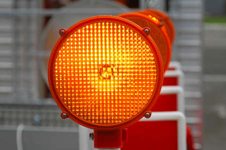 Amber beacon flashing lights for road works safety photo