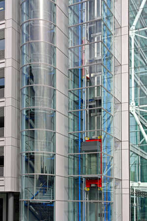 Glass elevator in modern new office building