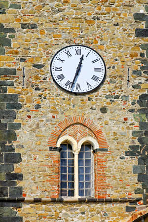 Medieval castle tower with clock in Italy Stock Photo - 18279730