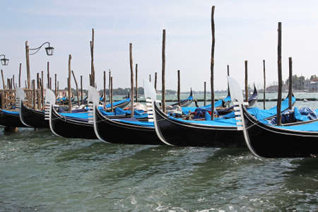 moorings: Traditional Venice Gondolas parked at their moorings Stock Photo