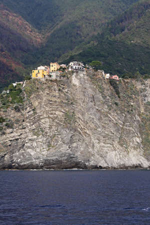 Corniglia village at cliff in Cinque Terre Italy photo