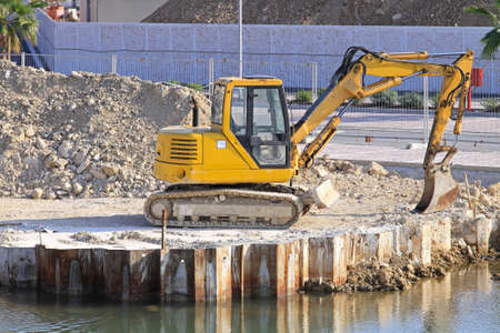 Yellow digger machine at canal construction site Stock Photo - 18295301