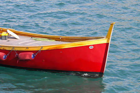 small boat: Close up shot of wooden red boat
